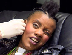 Toya Delazy takes Top Billing to the piercing parlour