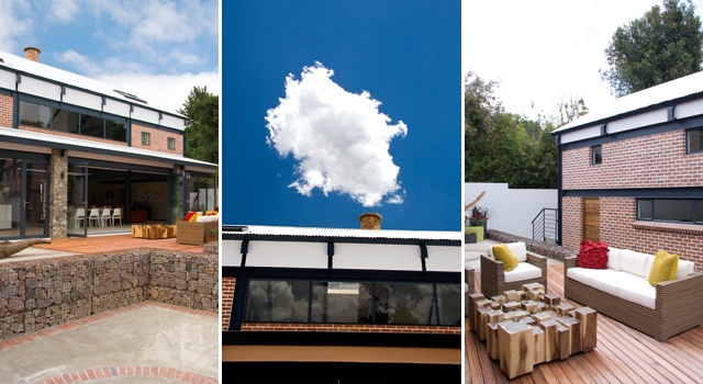 The chimney ascends the vertical height of the home, emerging beyond the roof through a skylight by Fabtec Skylite