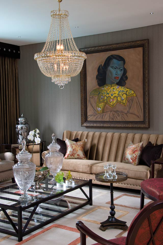 The lounge in pale gold and crystal finishes is the epitome of opulence. The reproduction Tretchikoff is by Mnandi.