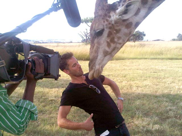 Top Billing presenter Janez Vermeiren kisses a giraffe