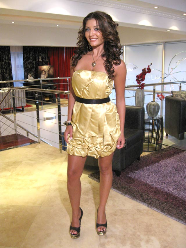 Top Billing Presenter Jeannie D's gold dress